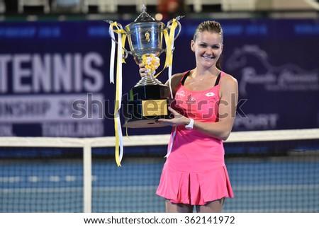 HUA HIN-JAN 1:Agnieszka Radwanska of Poland celebrates winning the gold medal during WORLD TENNIS THAILAND CHAMPIONSHIP 2016 at Hua Hin Centennial Club on January 1, 2016 in Hua Hin, Thailand - stock photo
