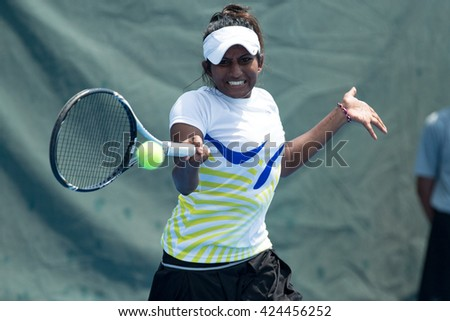 HUA HIN, THAILAND-APRIL 12:Amreetha Muttiah of Sri Lanka returns a ball during Day 2 of Fed Cup by BNP Paribas on April 12, 2016 at True Arena Hua Hin in Hua Hin, Thailand