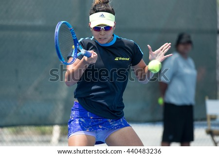 HUA HIN, THAILAND-APRIL 13:Anna Claire Patrimonio of Philippines returns a ball during Day 3 of Fed Cup by BNP Paribas on April 13, 2016 at True Arena Hua Hin in Hua Hin, Thailand