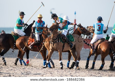 HUA HIN, THAILAND - APRIL 21: Macau Polo Team (green) plays against Thai Polo Team (blue) during 2013 Beach Polo Asia Championship on April 21 2013 in Hua Hin, Thailand. Thai Polo Team wins 5-2. - stock photo