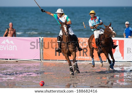 HUA HIN, THAILAND - APRIL 21: Macau Polo Team (L) plays against Thai Polo Team (R) during 2013 Beach Polo Asia Championship on April 21 2013 in Hua Hin, Thailand. Thai Polo Team wins 5-2. - stock photo