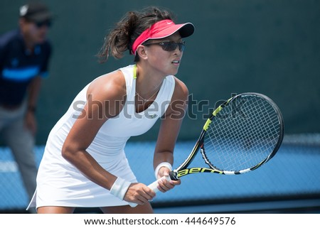 HUA HIN, THAILAND-APRIL 13:Melissa Tan of Singapore prepares to return a serve during Day 3 of Fed Cup by BNP Paribas on April 13, 2016 at True Arena Hua Hin in Hua Hin, Thailand