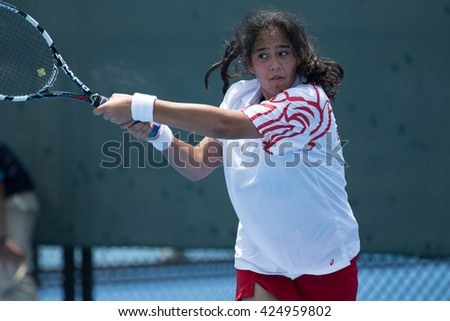 HUA HIN, THAILAND-APRIL 12:Nazli Nader Redha of Bahrain returns a ball during Day 2 of Fed Cup by BNP Paribas on April 12, 2016 at True Arena Hua Hin in Hua Hin, Thailand