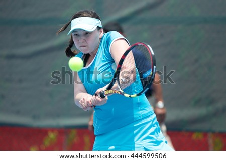HUA HIN, THAILAND-APRIL 13:Nelli Buyuklianova of Kyrgyzstan returns a ball during Day 3 of Fed Cup by BNP Paribas on April 13, 2016 at True Arena Hua Hin in Hua Hin, Thailand