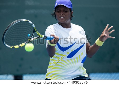 HUA HIN, THAILAND-APRIL 14:Nethmi Himashi Waduge of Sri Lanka returns a ball during Day 4 of Fed Cup by BNP Paribas on April 14, 2016 at True Arena Hua Hin in Hua Hin, Thailand