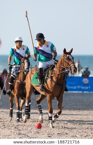 HUA HIN, THAILAND - APRIL 21: Two unidentified players of Macau Polo Team in action during 2013 Beach Polo Asia Championship on April 21 2013 in Hua Hin, Thailand. - stock photo