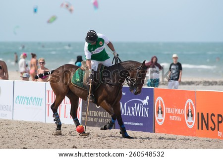 HUA HIN, THAILAND - APRIL 19: Unidentified player of Macau Polo Team in action during 2014 Beach Polo Asia Championship on April 19 2014 in Hua Hin, Thailand. - stock photo