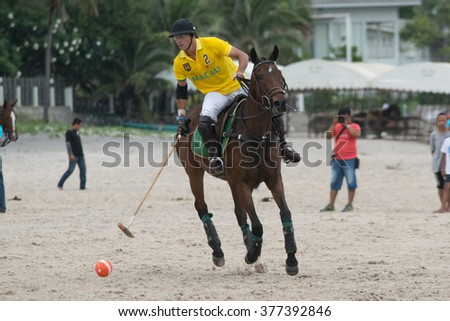 HUA HIN, THAILAND - APRIL 25: Unidentified player of Macau Polo Team in action during 2015 Beach Polo Asia Championship on April 25, 2015 in Hua Hin, Thailand. - stock photo