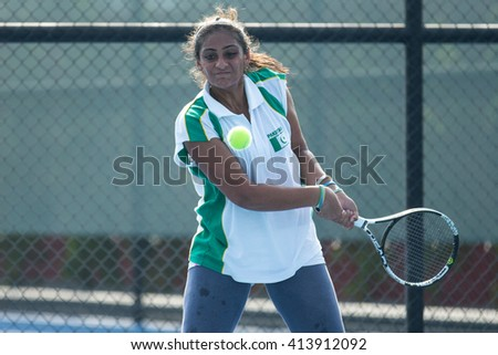 HUA HIN, THAILAND-APRIL 11:Ushna Suhail of Pakistan returns a ball during Day 1 of Fed Cup by BNP Paribas on April 11, 2016 at True Arena Hua Hin in Hua Hin, Thailand