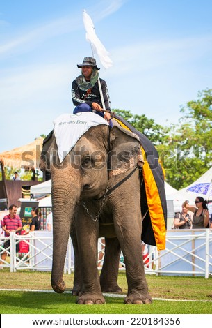 HUA HIN, THAILAND - AUGUST 28: Unidentified mahout.  Elephant polo games during the 2013 King 's Cup Elephant Polo match on August 28, 2013 at Suriyothai Camp in Hua Hin, Thailand. - stock photo