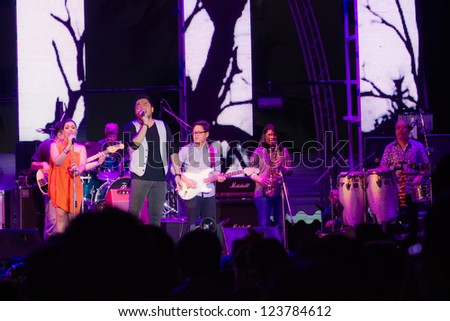 HUA HIN, THAILAND - DECEMBER 31 : Ben Chalatit performs live concert during Hua Hin Music Countdown 2013 on December 31, 2012 in Hua Hin, Prachuapkhirikhan, Thailand - stock photo