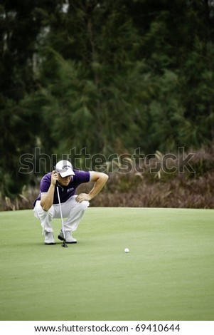 HUA HIN THAILAND - DECEMBER 17: Swedish golfer Alexander Noren thinks of his next move during Day 2 of Black Mountain Masters 2010 on December 17, 2010 at Black Mountain Golf Club in Hua Hin Thailand