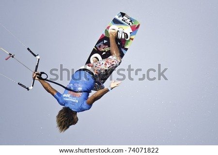 HUA HIN THAILAND - MARCH 14: PKRA Freestyle rider Robinson Hilario of Dominican Republic competes on Day 1 of 2011 Hua Hin Kiteboard World Cup on March 14, 2011 at Hua Hin Beach in Hua Hin, Thailand