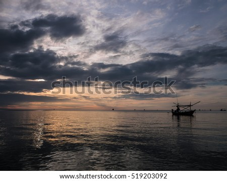 HUA HIN THAILAND : silhouette fishing boat on twilight sunrise time seascape