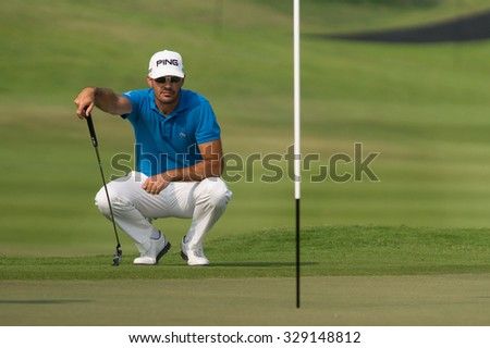 HUAHIN, THAILAND-FEBRUARY 12: Gregory Havret of France thinks of his next move during Round 1 of 2015 True Thailand Classic on February 12, 2015 at Black Mountain Golf Club in Hua Hin, Thailand
