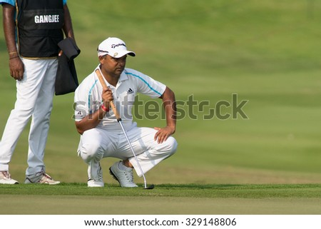 HUAHIN, THAILAND-FEBRUARY 12: Rahil Gangjee of India thinks of his next move during Round 1 of 2015 True Thailand Classic on February 12, 2015 at Black Mountain Golf Club in Hua Hin, Thailand