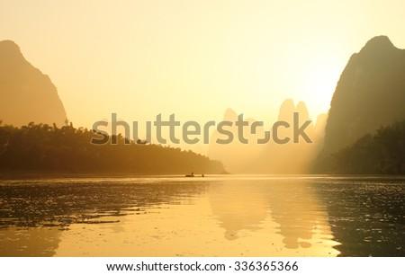 Huangbu (Yellow Cloth) Beach Sunrise on Li River, Xingping, Guilin, China. Xingping is a town in North Guangxi, China. It is 27 kilometers upstream from Yangshuo on the Li River - stock photo
