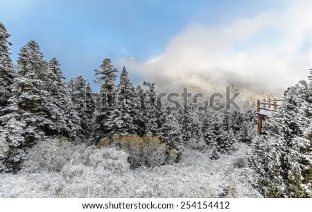 Huanglong National Park near Jiuzhaijou valley after snowfall - SiChuan, China - stock photo