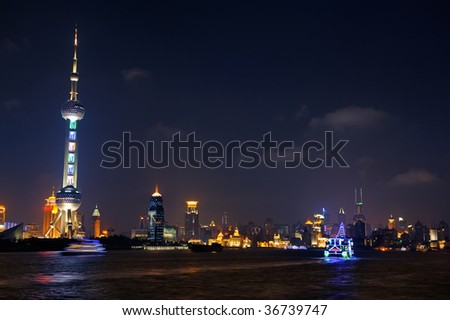 Huangpu river at night. Pudong financial district with Oriental Pearl tower. Shanghai, China 2009