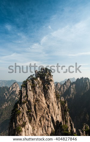 Huangshan Mountain Range - Anhui Province - China. Scenic landscape with steep cliffs and trees during a sunny day - stock photo