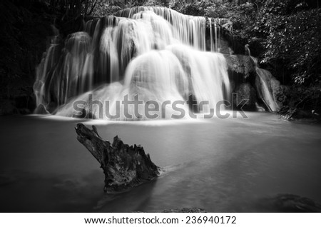 Huay Mae Kamin , beautiful waterfall in green forest, black and white - stock photo