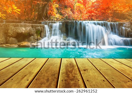 Huay Mae Kamin Waterfall and wood pier, beautiful waterfall in autumn forest, Kanchanaburi province, Thailand - stock photo