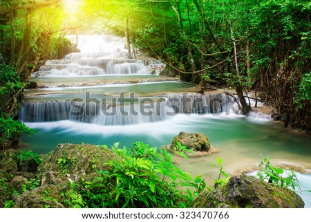 Huay Mae Khamin waterfall in tropical forest of national park with sun light, Thailand  - stock photo