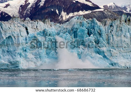 Hubbard Glacier calving. This is the longest tidewater glacier in Alaska, and its open calving face is over ten kilometers (6 miles) wide - stock photo