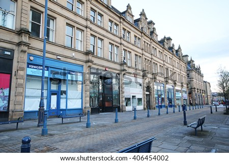 HUDDERSFIELD, UK - APRIL 16, 2016: Shops. Huddersfield is a large market town and the largest settlement in the metropolitan borough of Kirklees, West Yorkshire, - stock photo