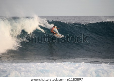 HUDHURANFUSHI ISLAND, MALDIVES - JUNE 29: Unidentified man surfing on huge wave of Indian Ocean of Maldives on 29 June 2009 Hudhuranfushi island is very popular place for surfers from over the world. - stock photo