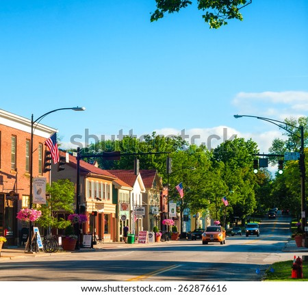 HUDSON, OH - JUNE 14, 2014: Main Street in Hudson is lined with quaint shops and businesses that go back more than a century, giving the NE Ohio village a unique charm. - stock photo