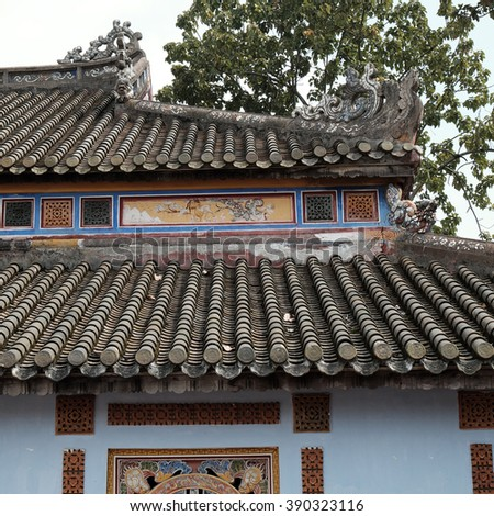 HUE, VIET NAM- FEB 19, 2016: Citadel, an culture heritage with Hoang Thanh (Imperial City),Tu Cam Thanh (Forbidden City), Dai Noi (Inner city), ngo mon (noon gate), detail of roof of ancient Vietnam
