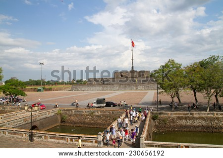 HUE, VIETNAM - SEPTEMBER 02: Tourists visitors citadel in Hue, Vietnam on September 02, 2011. Citadel in Hue is one of the famous attractions of the city. - stock photo
