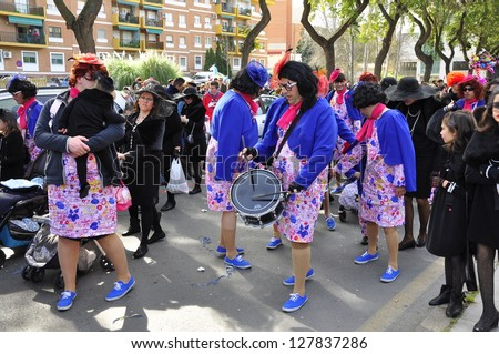 HUELVA, ANDALUSIA, SPAIN - FEBRUARY 10: The Carnival parade of Huelva, procession with people in traditional street, on February 10, 2013 in Huelva, Andalusia, Spain