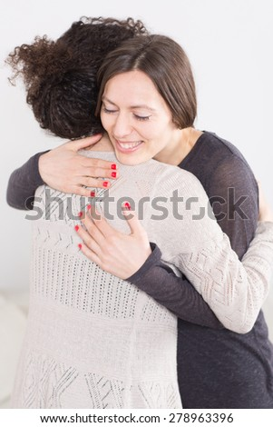 Hug a friend - stock photo