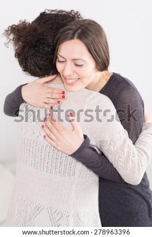 Hug a friend - stock photo