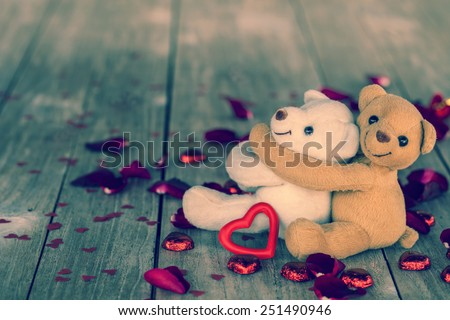 hug teddy bears for happy valentines  day on wood background, vi - stock photo