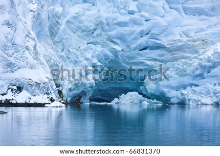 Huge Antarctic iceberg in the snow - stock photo