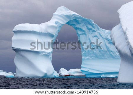 Huge Arch Shaped Iceberg - stock photo