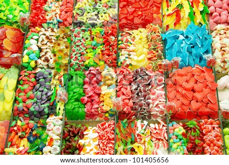 Huge bin of candy at the outdoor food market in Barcelona, Spain - stock photo