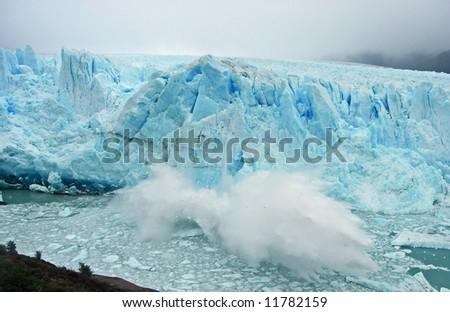 Huge block of ice falling of the Perito Moreno glacier, Argentina - stock photo