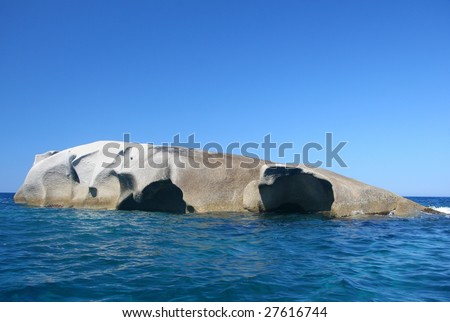 huge boulder in the sea - stock photo