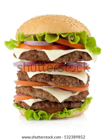 Huge burger with beef, cheese, onion and tomatoes. Isolated on white background