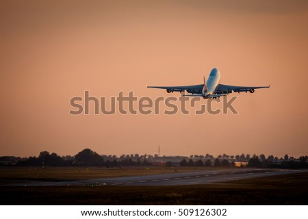 Huge cargo airplane take off during sunset