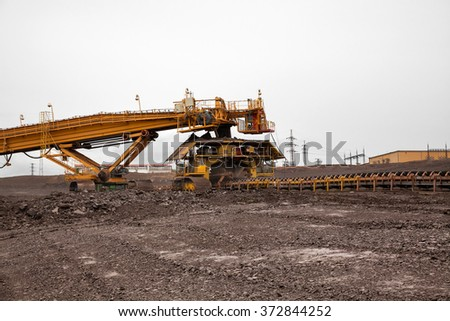 Huge coal loading conveyor belt piles coal
