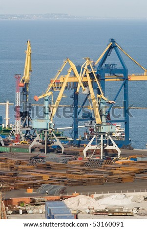 Huge cranes working at the commercial dock - stock photo