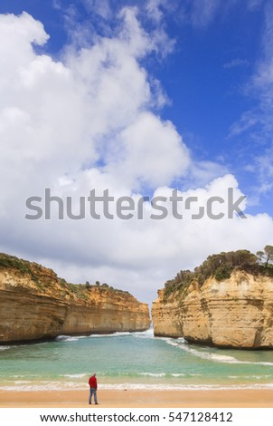 Huge cumulus clouds over the limestone cliffs and beach at Loch Ard Gorge, Great Ocean Road, Victoria, Australia.