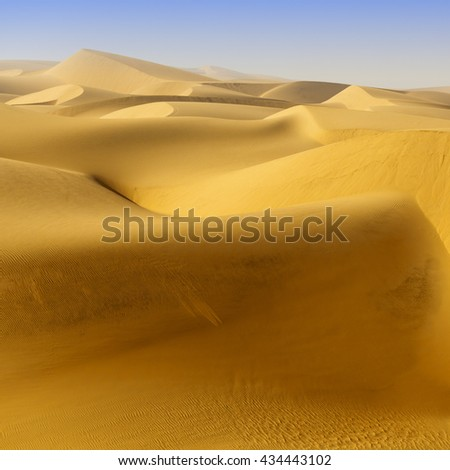 Huge dunes of the desert.  Beautiful structures of sandy barkhans. - stock photo
