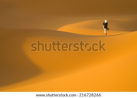 Huge dunes of the desert. Fine place for photographers and travelers. Beautiful structures of sandy barkhans. - stock photo