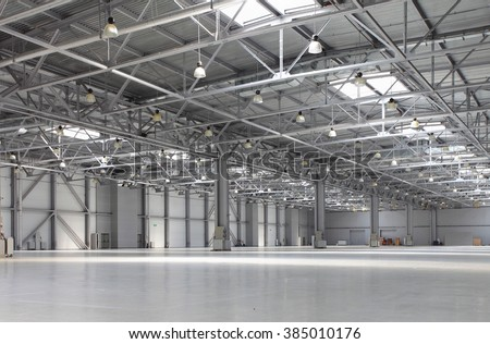 Huge empty warehouse - stock photo